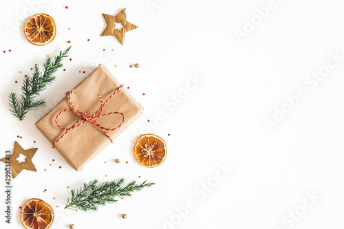 Poster Pierre, Sable Christmas composition. Gift box, fir tree branches, golden decorations on white background. Christmas, winter, new year concept. Flat lay, top view, copy space