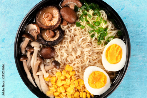 Foto auf Leinwand London Ramen close-up. Soba with eggs, mushrooms, and vegetables, shot from above on a blue background