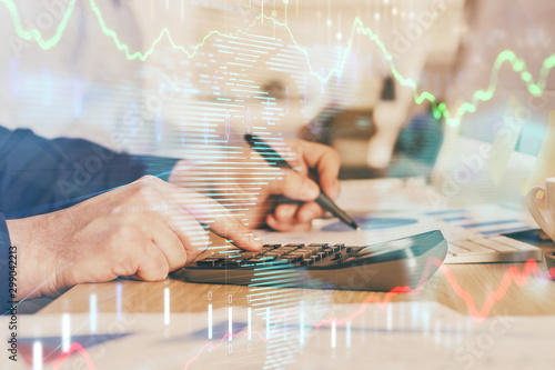 Fototapeta Financial trading graph multi exposure with man desktop background. obraz