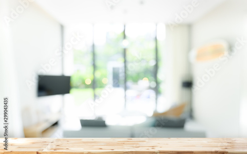 Wooden board empty table in front of blurred background. wood over blur in living room interior, can be used for display or montage your products. Mock up for display of product.