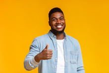 Smiling African American Man Showing Thumb Up At Camera