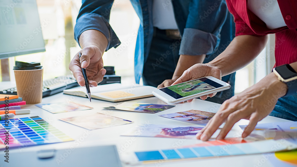 Fototapeta Advertising agency designer creative start-up team discussing ideas in office.