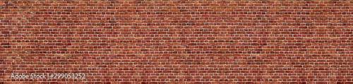 Fotografiet Old red brick wall background, wide panorama of masonry