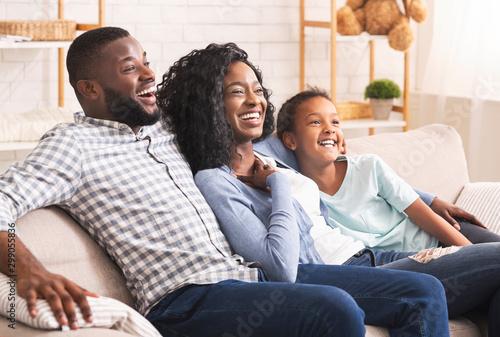 Joyful african american family watching comedy show on tv together Slika na platnu