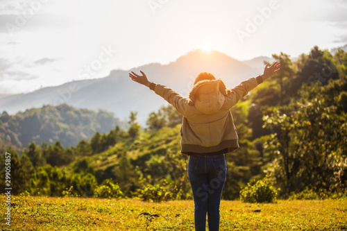 Foto op Plexiglas Weide, Moeras Young tourists, taking pictures, drinking water, Raising both arms happily standing a top the mountain. traveler concept