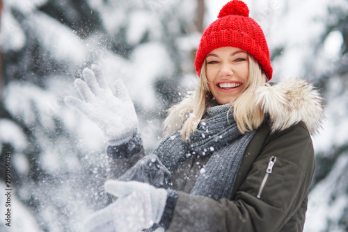 Fototapeta  Happy woman having fun over winter