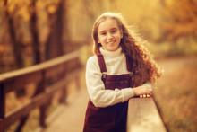 Portrait Of Cute Girl Leaning ...