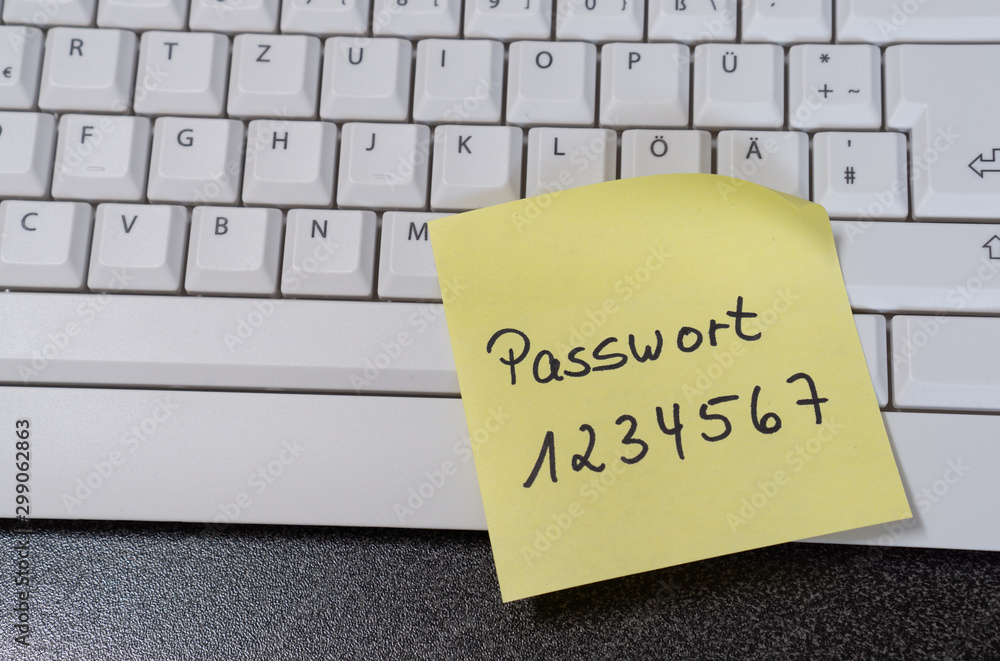 Fototapeta Note with the german word for password on a computer keyboard