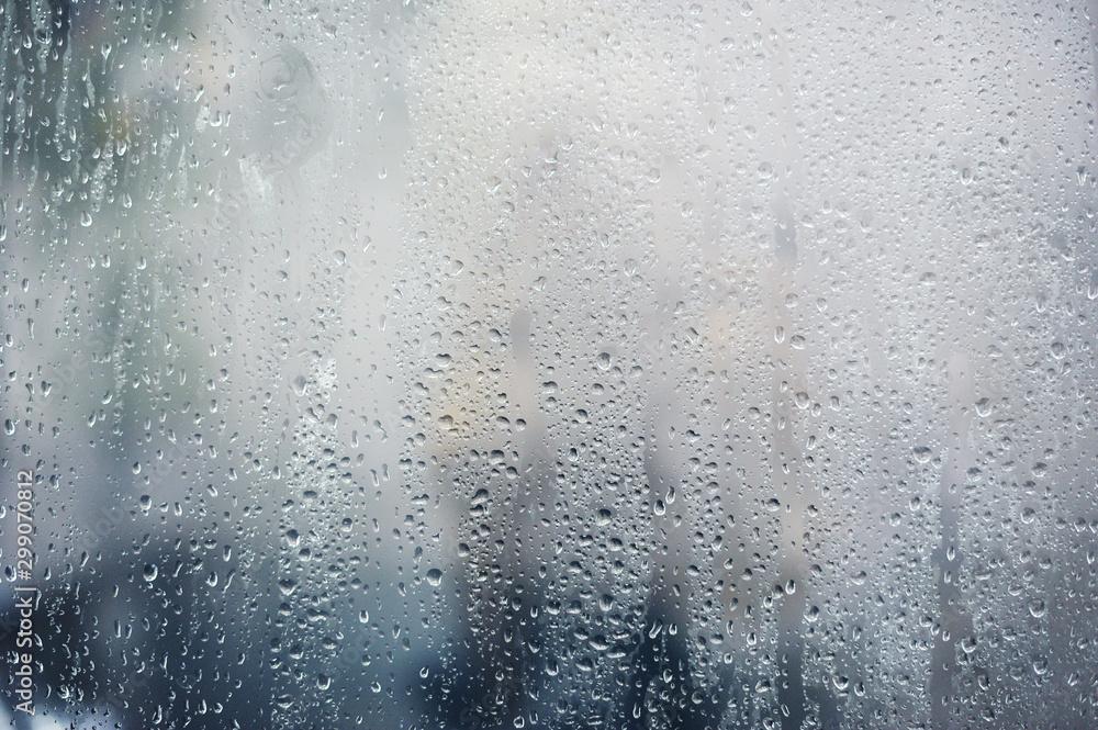 Fototapeta Rainy background, rain drops on the window, autumn season backdrop, abstract textured wallpaper