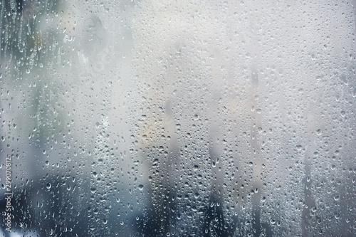 Fotografie, Obraz Rainy background, rain drops on the window, autumn season backdrop, abstract tex