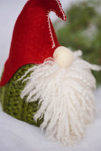 A Toy. Christmas Scandinavian Gnome In A Red Hat With A Beard