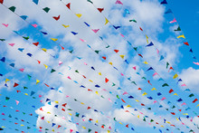 Party Colorful Flags Against B...