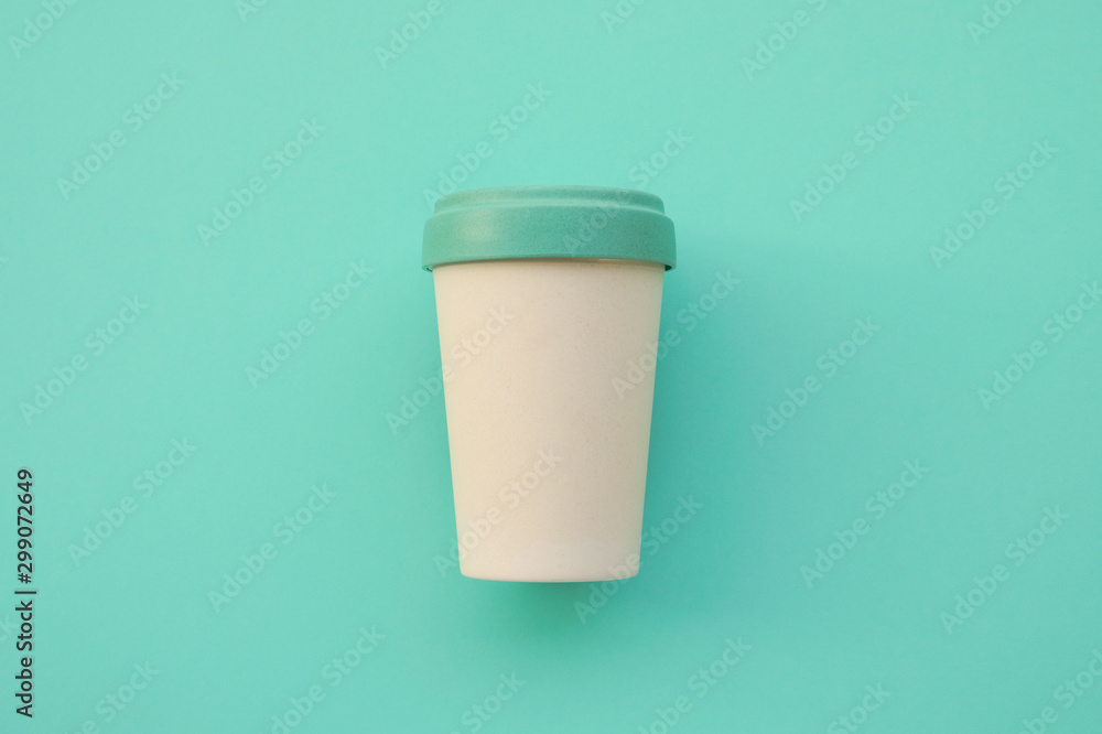 Fototapety, obrazy: Reusable eco friendly bamboo cup for take away coffee on mint background.