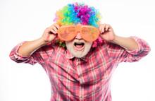 Man Senior Bearded Cheerful Person Wear Colorful Wig And Sunglasses. Elderly Clown. Having Fun. Funny Lifestyle. Fun And Entertainment. Comic Grandfather Concept. Nice Joke. Grandpa Always Fun