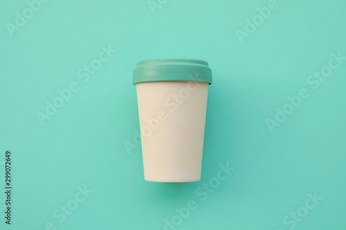 Reusable eco friendly bamboo cup for take away coffee on mint background. - 299072649