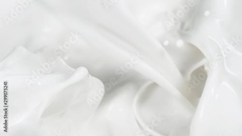 Macro shot of pouring cream in detail