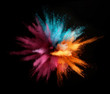canvas print picture - Explosion of colored powder isolated on black background