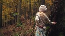 Little Girl In Hat Leans Again...