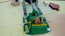 Rube Goldberg Machine. The Vise Squeezes And Splits The Nut. Rubber Pulls And Pulls The Rope.