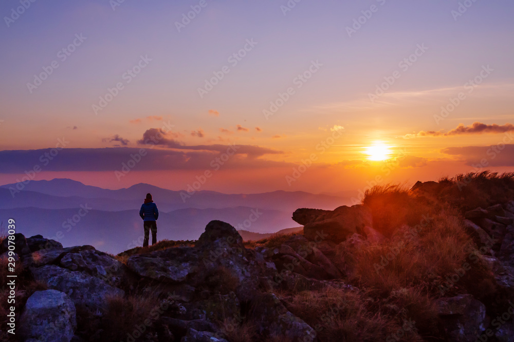 Fototapety, obrazy: Tourist watching sunset in the mountains