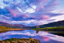 Ardvreck Castle Reflected With Sunset Colours On Loch Assynt