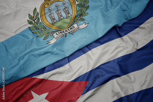 waving colorful flag of cuba and national flag of san marino. Wallpaper Mural