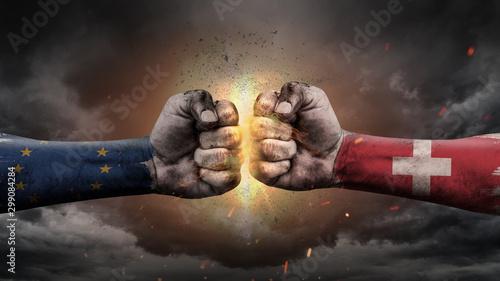 EU vs EU. Fists with flags. Battle EU with Switzerland  on sky. Obraz na płótnie