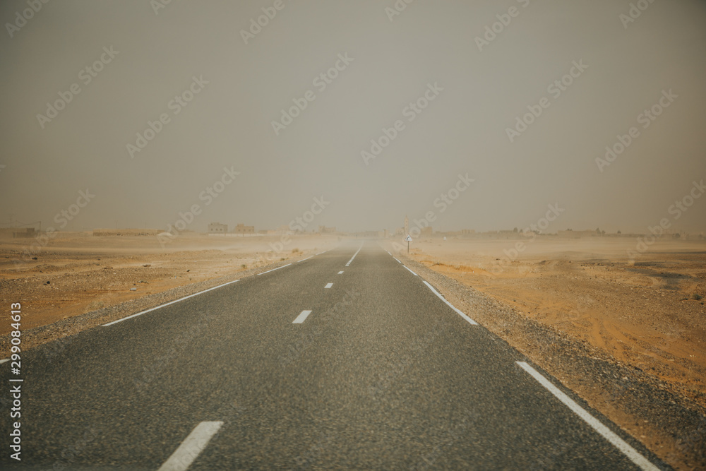 Fototapety, obrazy: Narrow road crossing africa during sand storm.