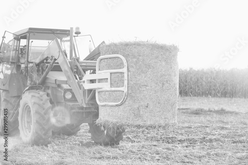 Black and white Photo of tractor with round hay bale Canvas Print
