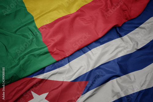 waving colorful flag of cuba and national flag of benin. Wallpaper Mural