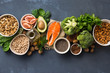 Leinwandbild Motiv Health food fitness. Food sources of omega 3 and omega 6 on dark background top view. Foods high in fatty acids including vegetables, seafood, nut and seeds