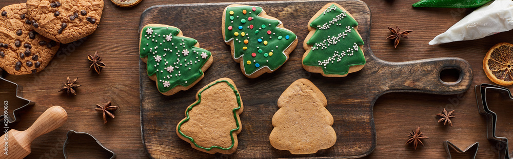 Fototapety, obrazy: top view of glazed Christmas cookies with pastry bag on wooden cutting board, panoramic shot