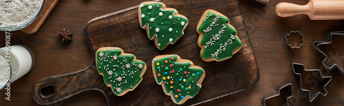 top view of glazed Christmas cookies on wooden table, panoramic shot Wallpaper Mural
