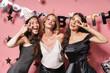 canvas print picture - Three cheerful pretty girls wearing dresses celebrating birthday