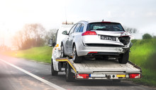 Loading Broken Car On A Tow Tr...