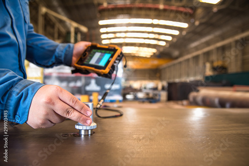 Photo  Ultrasonic test to detect imperfection or defect of steel plate in the factory, NDT Inspection