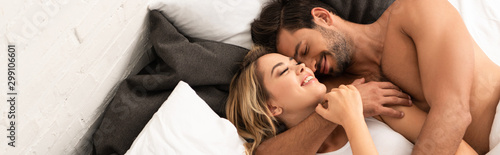 happy tender couple hugging in bed in the morning Canvas Print