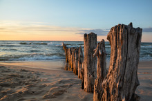Wooden Breakwater During Sunse...