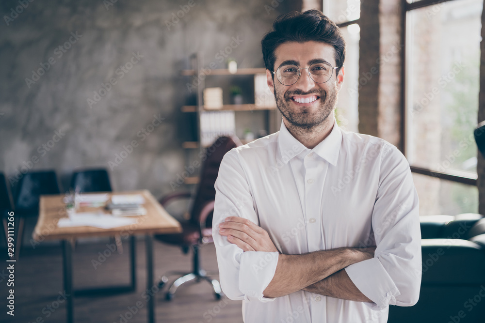 Fototapeta Portrait of positive cheerful middle eastern entrepreneur cross his hands feel real successful start-up owner in enterprise office