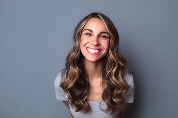Portrait of young beautiful cute cheerful girl smiling looking at camera.
