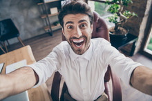 Close Up Photo Of Crazy Funky Funny Middle Eastern Business Man Make Selfie Have Online Meeting With Colleagues Scream Laugh Sit Chair In Loft