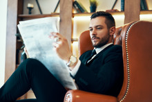 Confident Young Businessman Re...