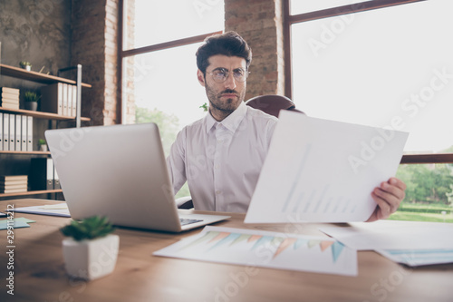 Fotografia Portrait of thoughtful middle eastern man agent sit table in loft company office