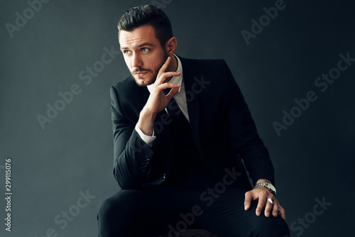 Fototapeta Elegant young man portrait on black background