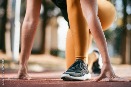 Fotografie, Obraz  Close up of woman in star position for running