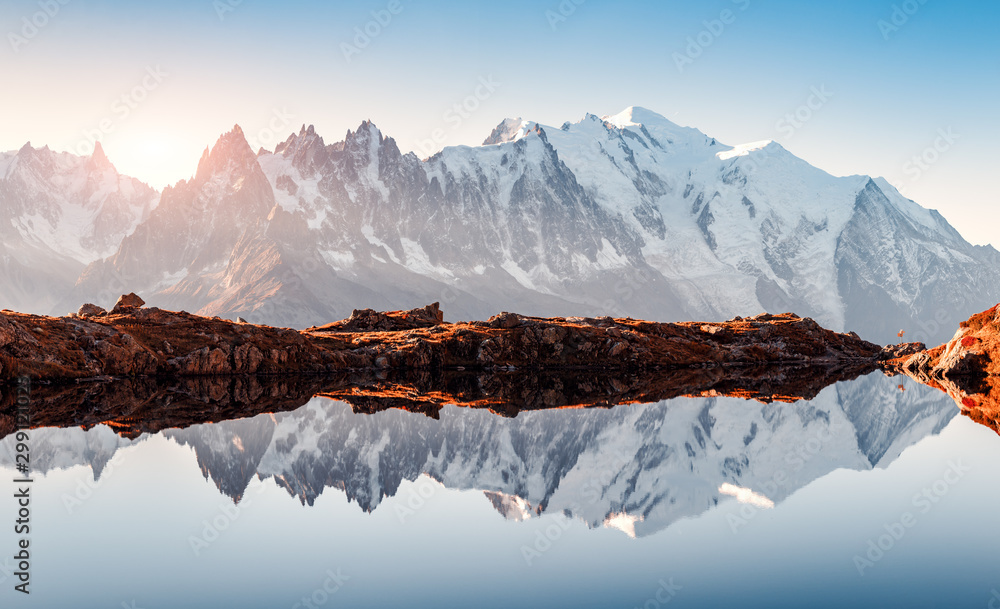 Obraz Incredible view of clear water and sky reflection on Chesery lake (Lac De Cheserys) in France Alps. Monte Bianco mountains range on background. Landscape photography, Chamonix. fototapeta, plakat