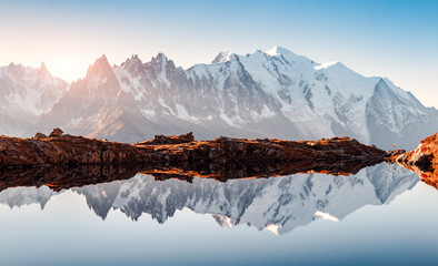 Fototapeta Krajobraz Incredible view of clear water and sky reflection on Chesery lake (Lac De Cheserys) in France Alps. Monte Bianco mountains range on background. Landscape photography, Chamonix.