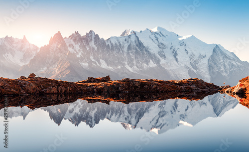 Obraz Incredible view of clear water and sky reflection on Chesery lake (Lac De Cheserys) in France Alps. Monte Bianco mountains range on background. Landscape photography, Chamonix. - fototapety do salonu