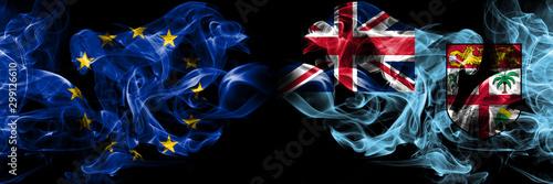 Eu, European union vs Fiji smoke flags placed side by side Fotobehang