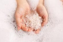White Bath Salt In A Female Ha...